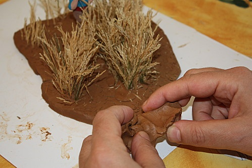 How to make a wheat field. (I wonder if you could make a corn maze for a Halloween village?)
