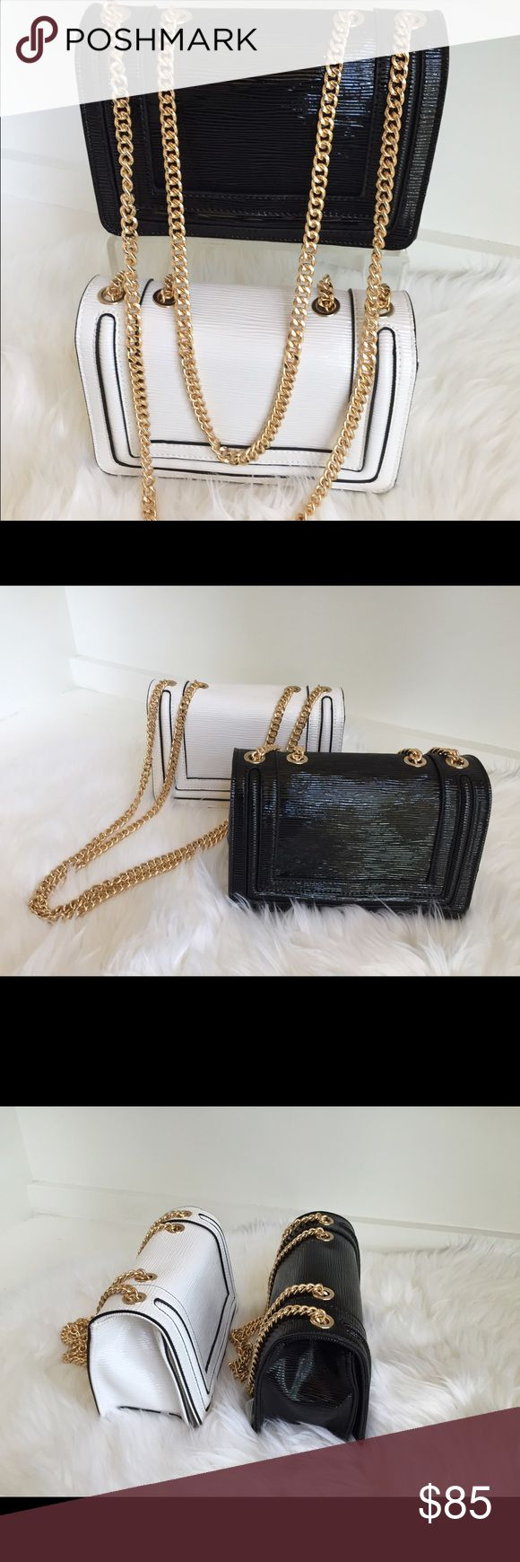 Italian gold chain clutches Beautiful evening or cocktail clutches adorned with gold chain. Perfect for a night in town or a soirée with friends . A must have , colors: Black and white Bags Clutches & Wristlets