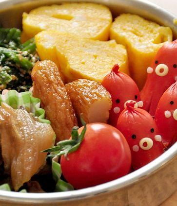 Typical Japanese Bento BoxedLunch (Oct Dog, Tamagoyaki Egg Roll, Spinach Gomaae Sesame Salad)