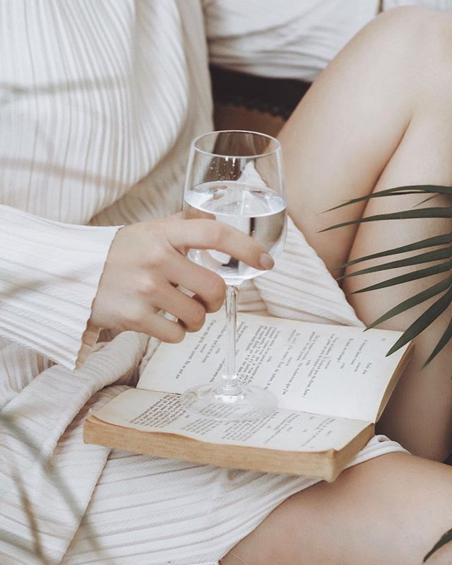 saturday nights spent reading and sipping perrier out of a wine glass. what about you?
