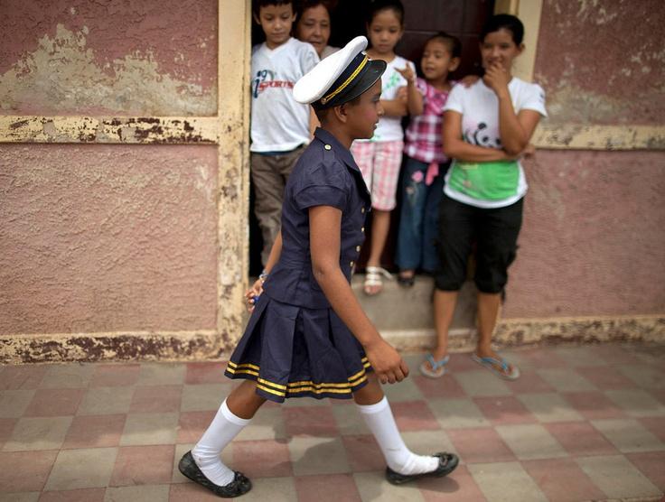 Children wearing gender-bending outfits dance during the 'El Cartel' celebration in honor of Saint Anne in Nandaime, Nicaragua, on July 28, 2012.