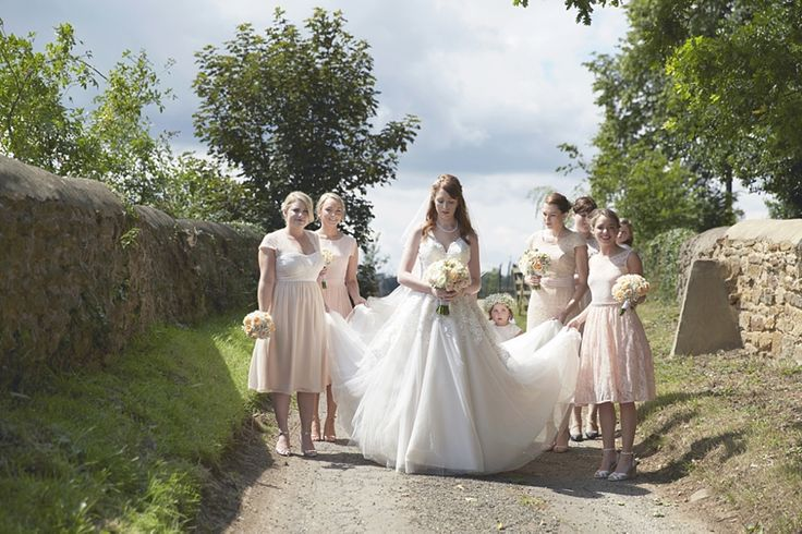 Blush wedding at Dodford Manor in Northampton with peach flowers and countryside views