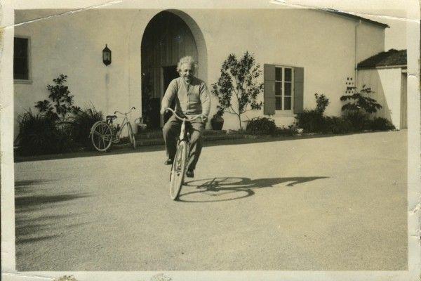 Albert Einstein riding bicycle in front of Ben Meyer's House; Santa Barbara, California