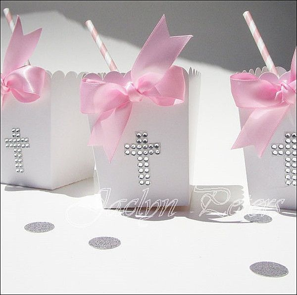 Beautiful silver rhinestone cross popcorn favor boxes each features a luxury, pink double satin ribbon hand tied bow. Baptism and Communion tables and dessert b