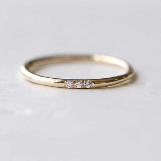 DETAILS The tri-diamond band is our new favorite piece. Dainty and perfect for a wedding, promise ring, anniversary present, push present or graduation gift! 1.