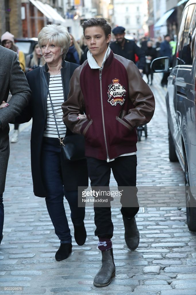 Romeo Beckham (age 15) and Sandra Beckham attend the Kent & Curwen Presentation at the Floral St Kent & Curwen store during London Fashion Week Men's January 2018 on January 7, 2018 in London, England.