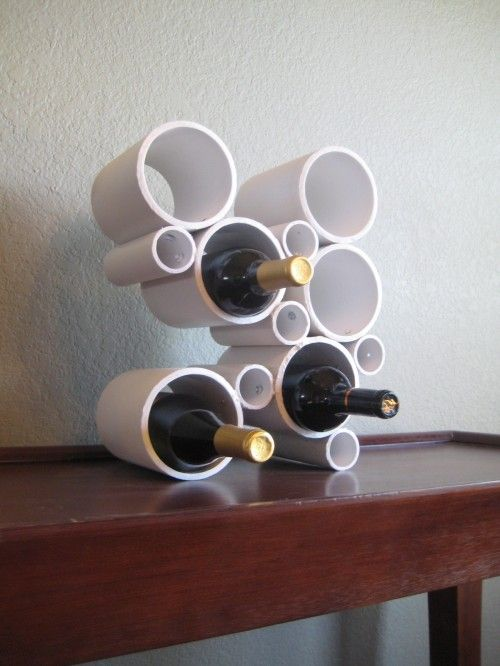 PVC pipe DIY wine rack...pretty cool. Can paint it any color!