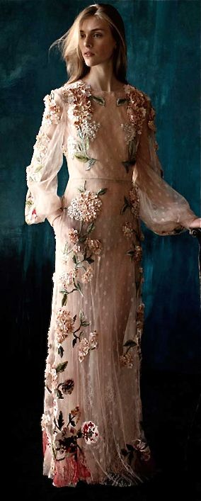 Valentino.  But my praise is for the team that made this dress, what skill!!