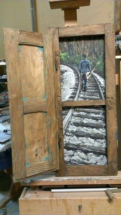 Ventana reciclada y pintura acrilica