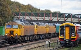 57312/301/306 approach Basingstoke hauling two Arlington barrier coaches as the 0958 Peterborough-Eastleigh Works on November 5 2013. MARK PIKE.
