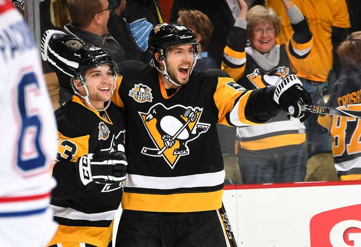 Penguins vs. Canadiens - 12/31/2016 - Pittsburgh Penguins - Photos  Conor Sheary #43 of the Pittsburgh Penguins celebrate with Kris Letang #58 after scoring in the third period to tie the game.