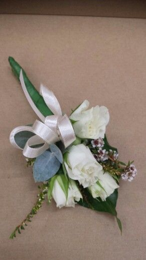 Ladies pin on corsage white spray roses
