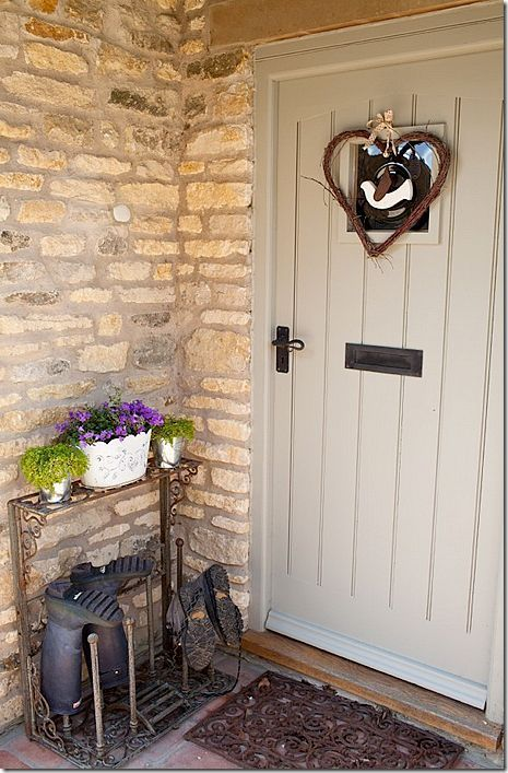 Love this old boot rack by a family entrance