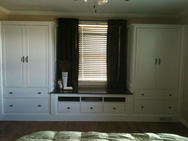 two Hemnes wardrobes and a TV unit joined to look like a built-in