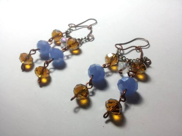Copper's earrings relized qith bronzely and violet stones! For info contact me to: immacolataspinelli@gmail.com
