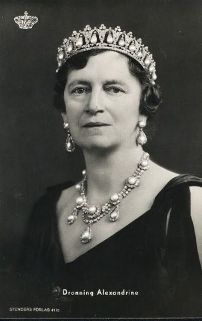 Queen Alexandrine of Denmark was given the pearl and diamond necklace and earrings as a wedding present in 1869 by the Khedive of Egypt. She is also wearing the Pearl Poiré Tiara.