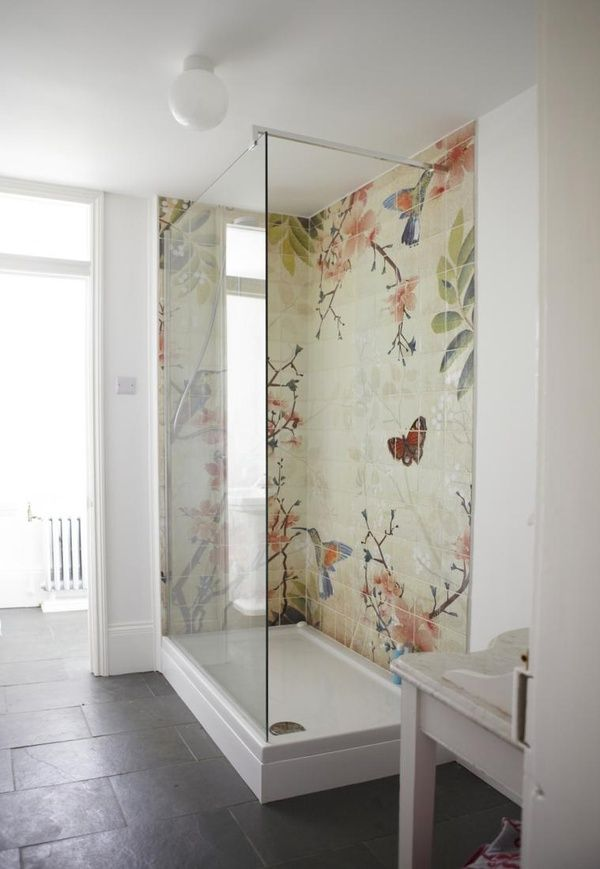 Love the completely white bathroom and then the splash of color depicted in the shower tiles motif