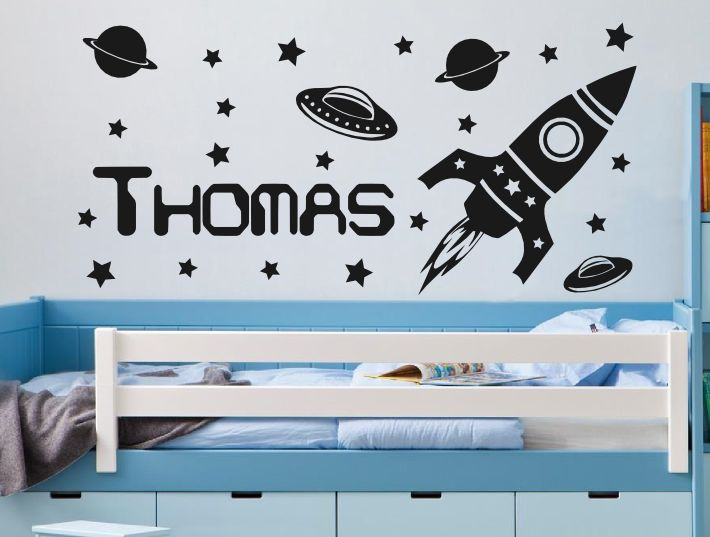 Boys bedroom wall stickers of a rocket ship flying off among the stars with your boys name displayed next to the rocket the personalised rocket wall