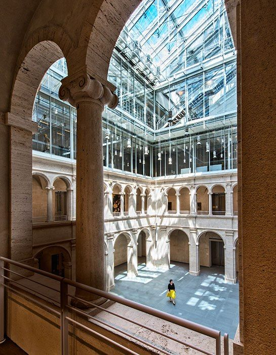 Crowning it all is a spectacular glass canopy that bathes the interiors in diffuse natural light—most strikingly in the updated Calderwood Courtyard (shown), an arcaded neoclassical atrium that serves as the complex's center.