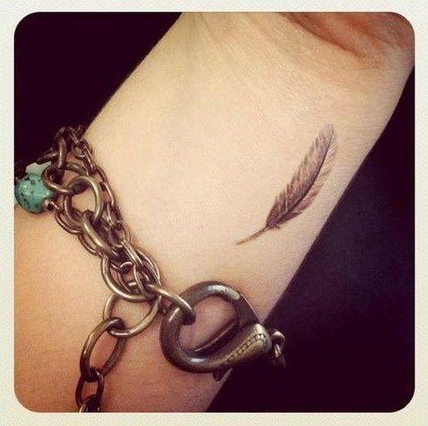 feather tattoo wrist tattoo