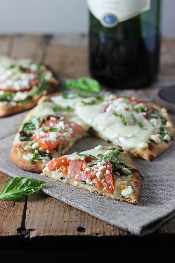 Flatbread pizza with caramelized onions, spinach, feta & tomatoes.