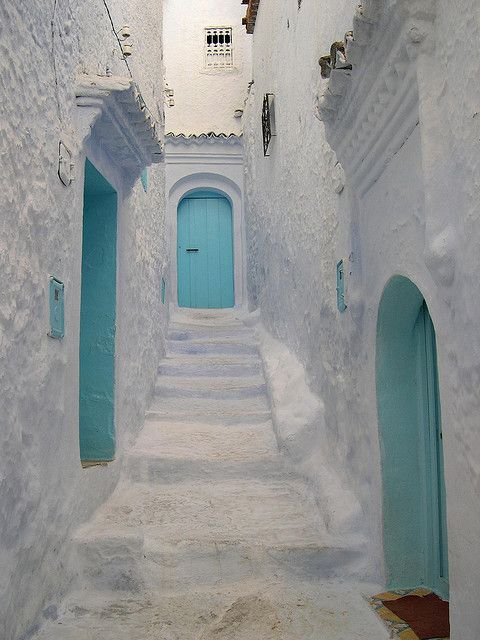 White and turquoise in Chefchaouen, Morocco. Chefchaouen is known for its buildings in shades of blue.
