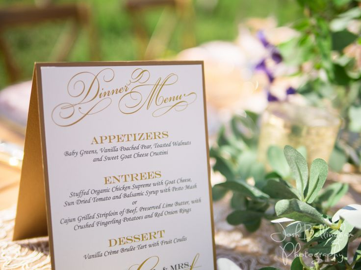 Shimmering details of wedding menu created by Charmed Occasions in Niagara, Canada. Beautiful gold and white and blush colors for a wedding reception in an Orchard. Stunning Table decor with lush flowers. @pambocb @niunia1977 @WarehouseNOTL @constellationev @orchardcroft #JoshBellinghamPhotography