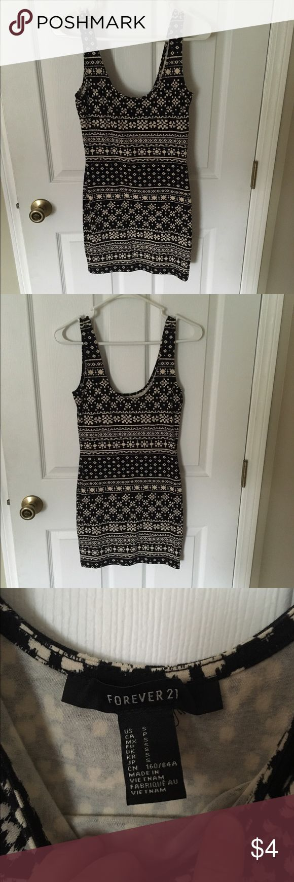 Forever 21 black and cream patterned bodycon dress Size small bodycon dress from forever 21. Like new condition. I'm almost certain I never wore it, but did remove the tags. Forever 21 Dresses Mini