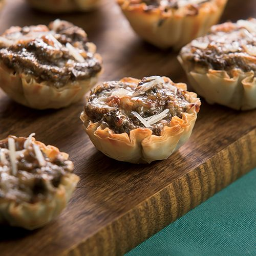 Bursting with fresh herbs and creamy gruyere cheese, these bite-sized mushroom tarts are full of flavor.