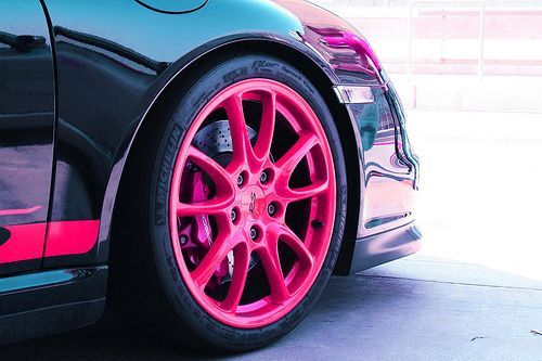 Pink rims on black. Want to do this to my car!