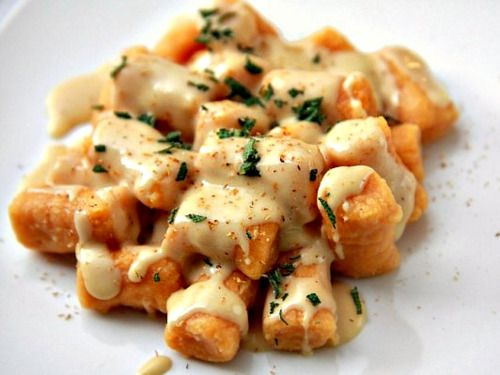 Gnocchi with gouda cheese sauce  http://tastykitchen.com/recipes/main-courses/sweet-potato-gnocchi-with-gouda-cheese-sauce/