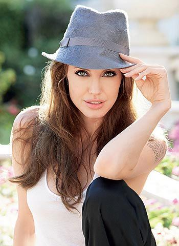 What can I say... Confidence is sexy! -- Angelina Jolie in a grey fedora
