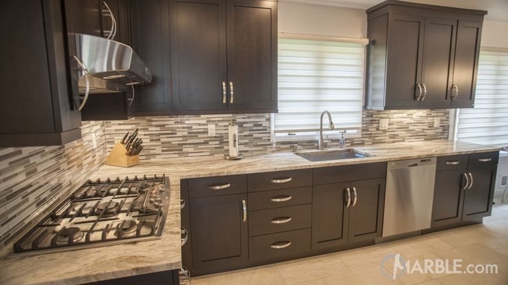 Kitchen With Dark Cabinets And Countertops