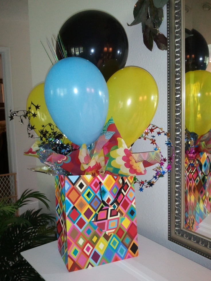 I chose gift bags to make these balloon centerpieces in