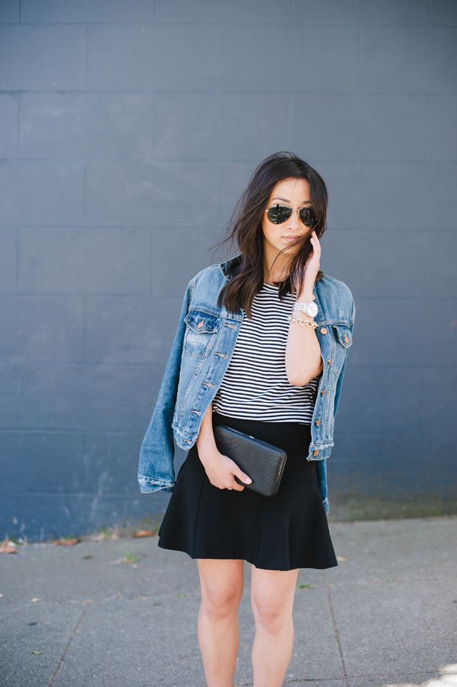 Blogger Crystalin Marie dresses up her Gap denim jacket with a feminine skirt and clutch.