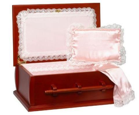 This elegant wooden pet casket is hand-crafted from cherry wood and contains a high-quality white cloth lining and a plush white pillow. This casket is one of the finest pet caskets available in the U