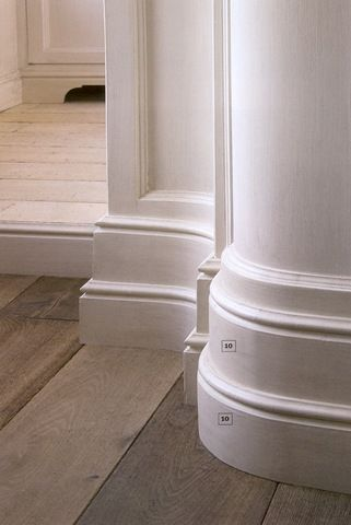 Curved and stacked.  Beautiful stacked trim, and wide plank floors