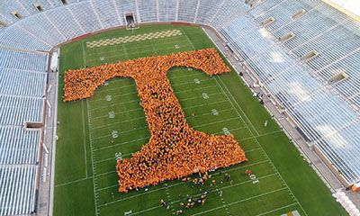 With more than 3,100 students, about 700 faculty, staff, and retirees, about 400 alumni, and one bluetick coonhound, UT this morning set the GUINNESS WORLD RECORD title for the largest human letter. Volunteers stood together in Neyland Stadium to create a Power T that spanned 190 feet by 190 feet. NBC's <em>Today</em> show viewers witnessed the feat, which was part of Rokerthon 3, weatherman Al Roker's week-long trek to five universities to break world records.