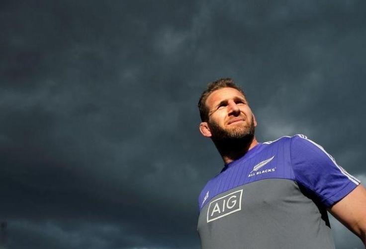 The New Zealand All Blacks rugby team captain Kieran Read walks under cloudy…
