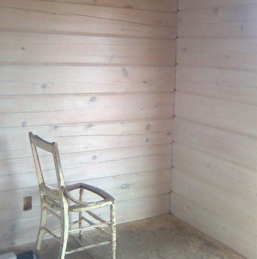 Horizontal pickled wood wall treatment. Cottagey. Architectural. But inexpensive.