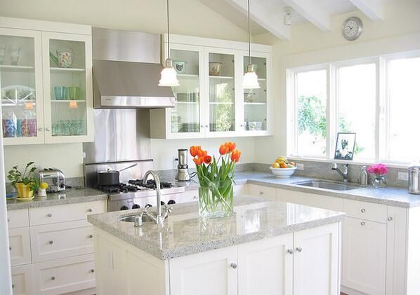 Kitchen - light gray countertops with white cabinets