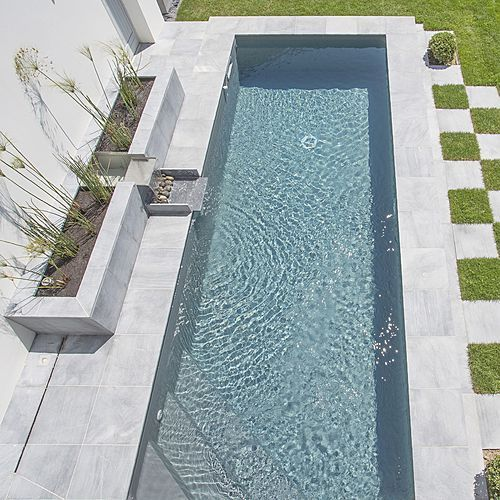 mini pool 2.50 mx 6.42 m - elevated style pool with fountain flowing into the pool surrounds natural stone panels - 100% concrete staircase inside corner - slate gray liner - near the pool water basins - salt chlorinator equipment - heating exchanger...