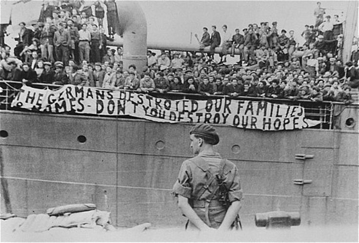"The ma'apilim of the ship Theodor Herzl display an anti-British banner in the port of Haifa: ""The Germans destroyed our families and our homes, Don't you destroy our hopes!"""