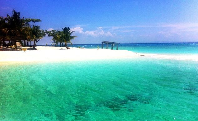 """""""The tiny island of Kalanggaman off the coast of Leyte in the Philippines. Its unadulterated state, sand bars, stunning rock formations, dwarf coconut trees, talcum fine white sand beaches, and amazing turquoise waters were absolute reasons for me to hail my experience there as my best island adventure ever."""" (From: 35 Beautiful Beaches You'd Love to Be On)"""