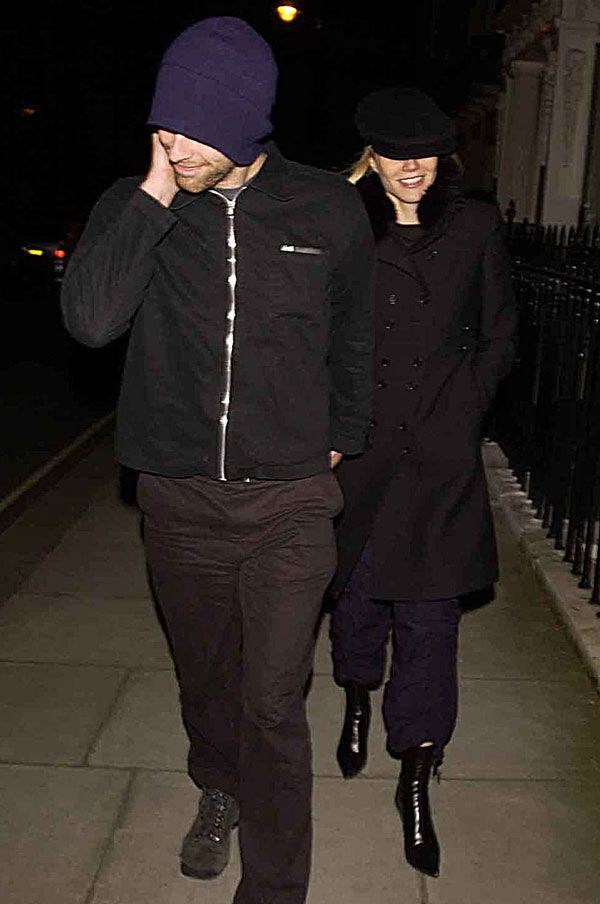 February 19, 2003 Gwyneth and Chris cover up together in London.