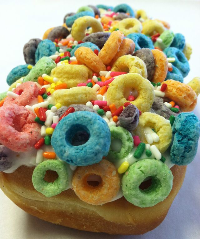 The Gay Bar: Fruit Loops cereal and rainbow sprinkles on a raised bar donut, from Psycho Donuts.