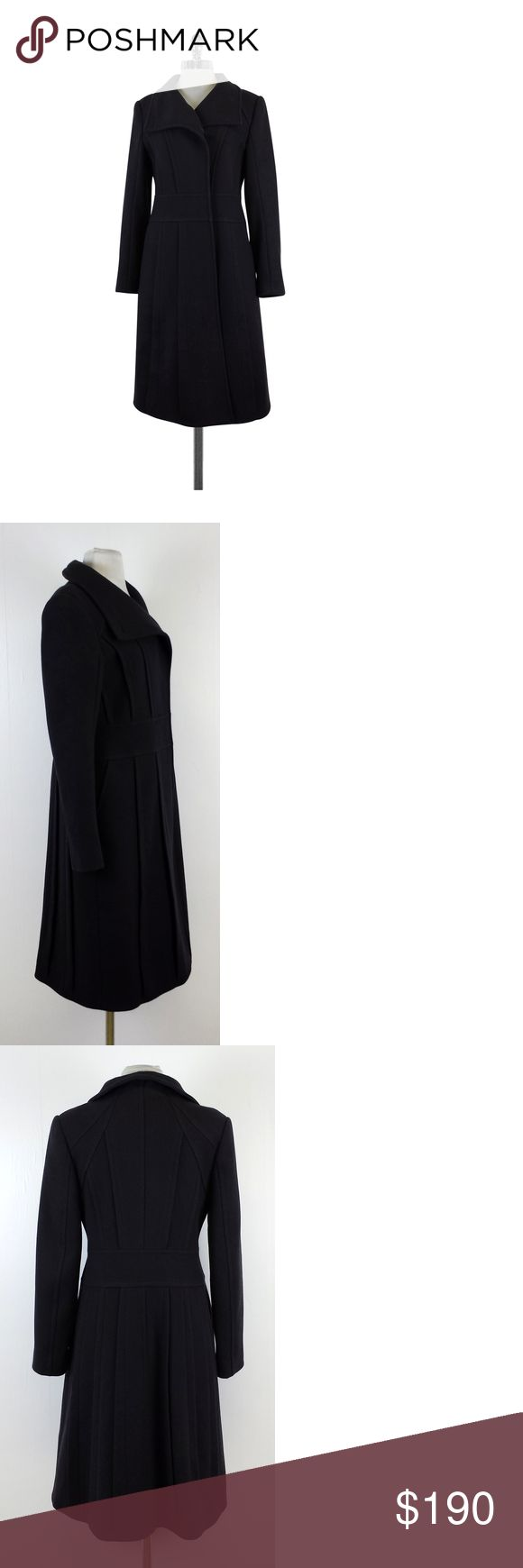 """Reiss- Charcoal Wool Coat Sz M This charcoal wool coat will keep you warm & stylish during the coldest of days. This timeless basic pairs well with everything in your closet. Size Medium Body 80% Wool 20% Polyamide Lining 100% Viscose Buttons on front Lightly padded shoulders Side pockets Waist 35"""" Shoulder to Hem 41.5"""" Founded in 1971, Reiss has won a loyal fanbase thanks to its exceptional quality and directional, design-led collections. Offering everything from fine tailoring to…"""
