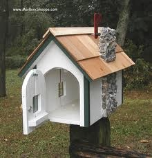 Wood Cottage Mailbox. This unique mailbox is made from wood and painted with exterior paints. It features a real stone chimney.