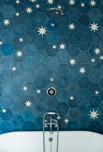 Hexagon tile in dark blue with start bursts. This is amazing amazing