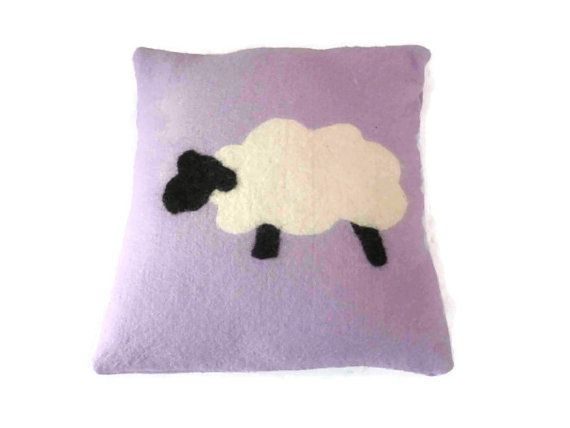 Wet felted by hand this 100% lilac wool felt cushion/ pillow is super soft and snuggly. The sheep is felted onto the cushion rather than sewn on. The